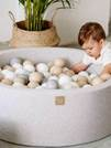 Description: Description: A baby playing with eggs  Description automatically generated with medium confidence