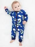 Description: Description: A baby in pajamas  Description automatically generated with low confidence