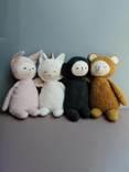 Description: Description: A group of stuffed animals  Description automatically generated